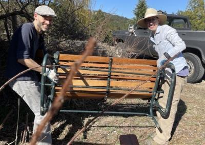 Volunteers bring out lawn furniture.