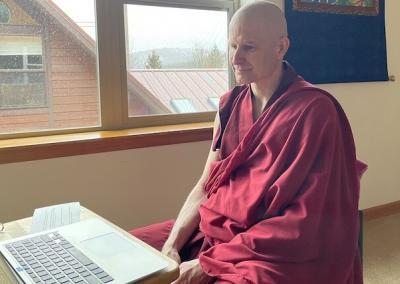 Monk listens to discussion group.