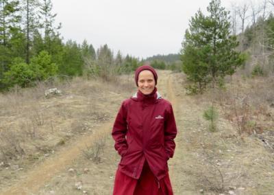 Nun walks to pond.