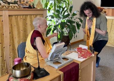 Man thanks Abbess for teachings.