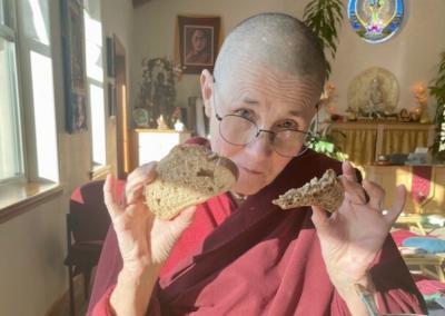 Nun eats bread.