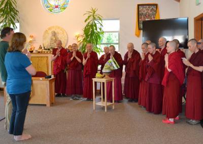 Monastics receive food offering.