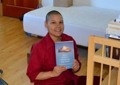 Nun with book.