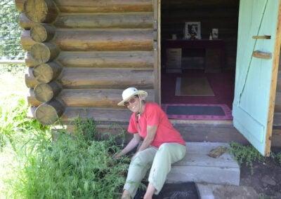 Woman plants herbs.