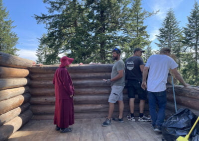 Abbess visits builders.