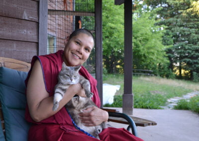 Nun holds cat.