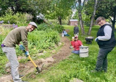 Guests work in garden.