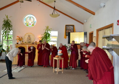 Nuns receive food offering.