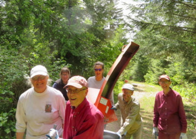 Nuns and guests work in forest.