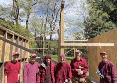 Nuns and monk build woodshed.