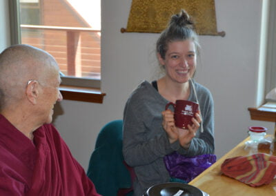 Guest receives cup gift.