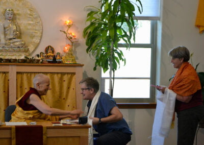 Guests thank abbess for teaching.