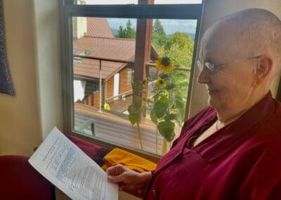 Nun reads schedule.
