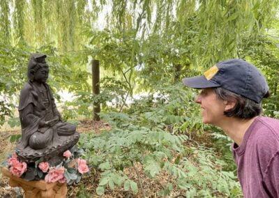 Woman prays to Buddha.