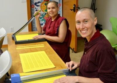 Nuns cut mantra rolls.