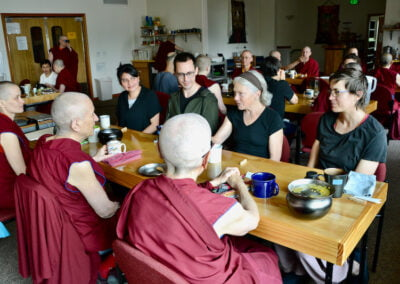 Nuns eat with guests.