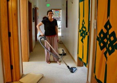 Woman cleans building.
