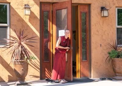 Nun opens door.