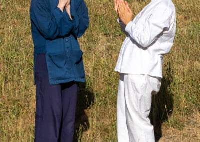 Monastic ordination candidates bow.
