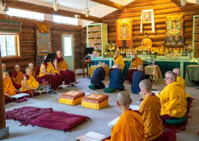 Monastic trainees kneel.