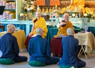 Nun blesses monastic trainees.