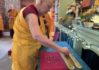 Nun arranges incense.