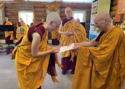 Preceptor gives nun ordination certificate.