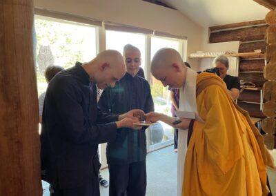 Nun gifts statues to anagarikas.