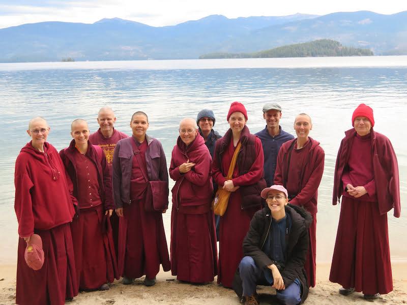 Nuns and guests at lake.