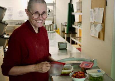 Nun puts out food.