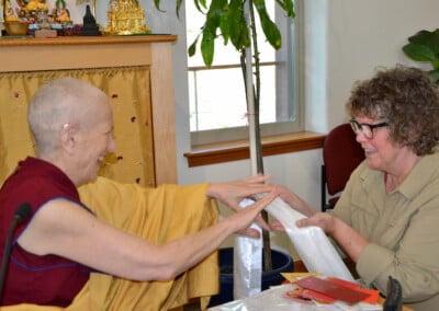 Nun offers thanks to teacher.