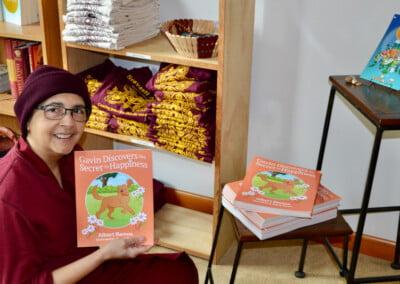 Nun hold children's book