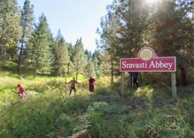 People in field near sign