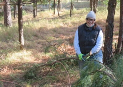 Smiling woman with pine branch