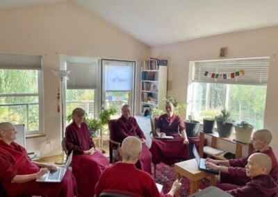 A circle of nuns meeting inside