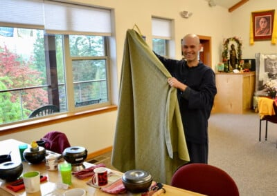 Man holds table cloth