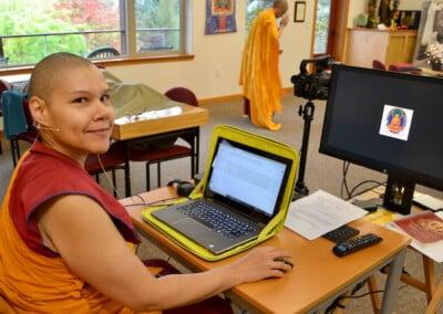 Nun sits at computer