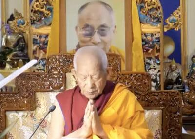 Tibetan monk prays